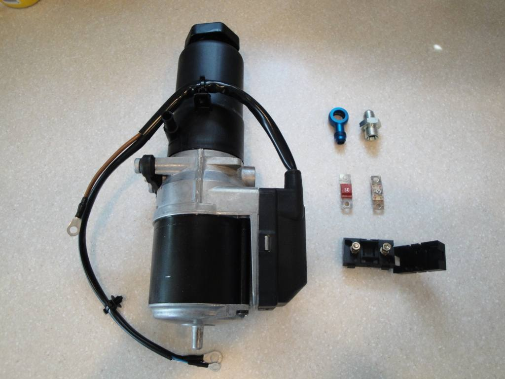 Basic Kit Includes Electric Ps Pump With Built In Reservoir Also Included Are The Adapters You Need Hose S As Well A Modified Oil Cooler For E36 Can